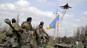 Ukrainian military watch a ukrainian jet take off